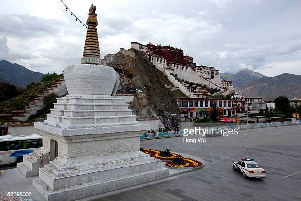 A picture shows a police car passes by the Potala Palace on August 19 2012 in Lhasa China After QinghaiTibet Railway went into operation on July 1...
