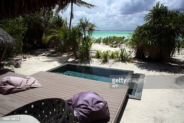 A picture shows a pool outside a bungalow at The Brando an ecofriendly resort on the private island of Tetiaroa on December 10 2013 After two years...