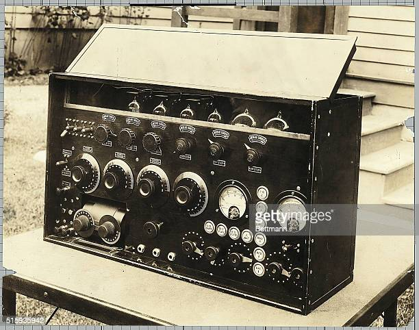 1922 Picture shows a portrait of a radio transmitter sitting on a table outside