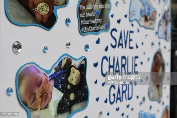 A picture shows a poster set up by supporters of the family of British baby Charlie Gard outside the Royal Courts of Justice in London on July 24...