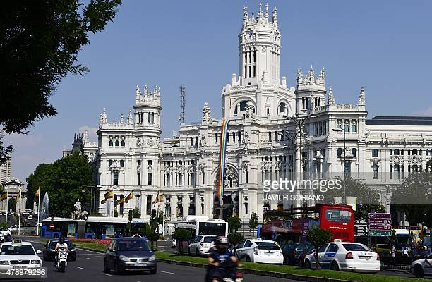 Picture shows a rainbow flag commonly known as the gay pride flag hanging from the Cibeles Palace facade Madrid cityhall headquarters on June 29 2015...