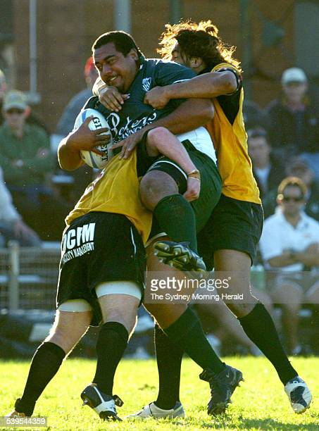 Picture shows a Randwick player getting a workout from the Penrith defence at Coogee Oval this afternoon 28 May 2005 SMH Picture by DALLAS KILPONEN