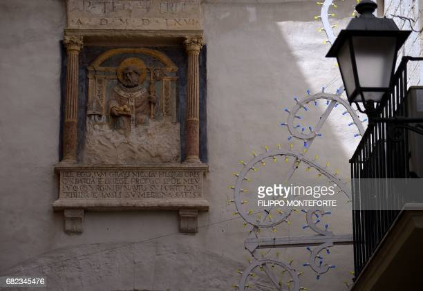 A picture shows a religious icon in the historic center of Bari on May 12 2017 G7 finance ministers met today in Bari looking for common ground amid...