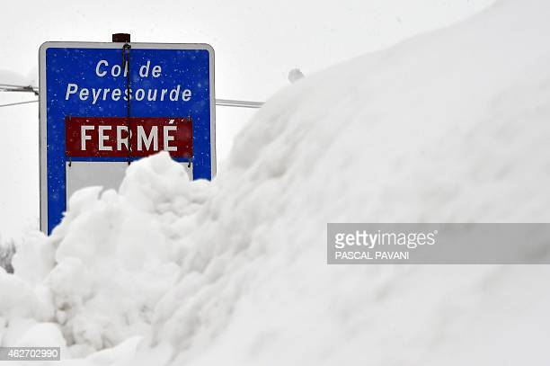 A picture shows a road sign covered by snow at the the Peyresourde pass on February 3 2015 near SaintLarySoulan southern France French authorities...
