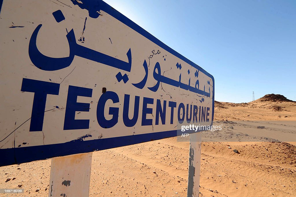 A picture shows a road sign indicating Tiguentourine near In Amenas on a road leading to a gas complex where Islamist gunmen had taken hostages in the desert in Algeria's deep south on January 19, 2013. Islamist gunmen killed seven foreign hostages in Algeria before being gunned down by special forces in a final assault on a remote desert gas complex, state television said. The 11 heavily armed men from a group known as 'Signatories in Blood' had been holed up at the In Amenas complex since they took hundreds of workers hostage in a dawn attack.
