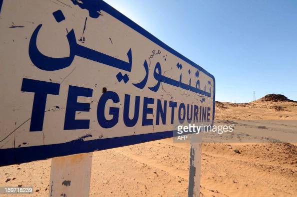 A picture shows a road sign indicating Tiguentourine near In Amenas on a road leading to a gas complex where Islamist gunmen had taken hostages in...