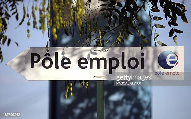 A picture shows a road sign with the logo of France's national employment agency Pole Emploi on October 24 2013 in Montpellier southern France The...