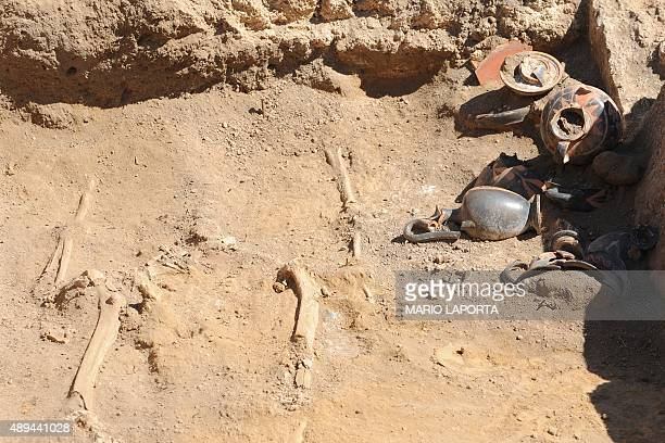 A picture shows a Samnite tomb of the fourth century BC with a woman's skeleton and many amphoras discovered inside ancient ruins of Pompeii during a...