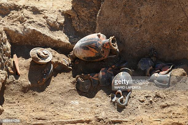 A picture shows a Samnite tomb of the fourth century BC with amphoras discovered inside ancient ruins of Pompeii during a press conference on...