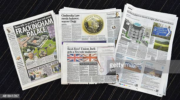 A picture shows a selection of April Fool's Day newspaper reports in London on April 1 2014 An independent Scotland would drive on the right replace...