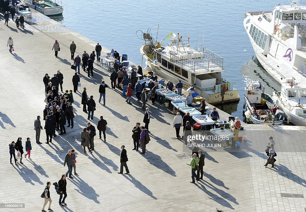 A picture shows a semi-pedestrian area where fishermen sell fish in the Vieux-Port district (old harbor) in Marseille, southern France, on January 7, 2013, as part of urban renewal by British architect Norman Foster for 'Marseille-Provence European Capital of Culture' in 2013.