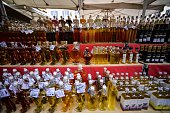 A picture shows a stall of Italian oil and vinegars at the Campo di Fiori food market in central Rome on November 4 2014 AFP PHOTO / ANDREAS SOLARO