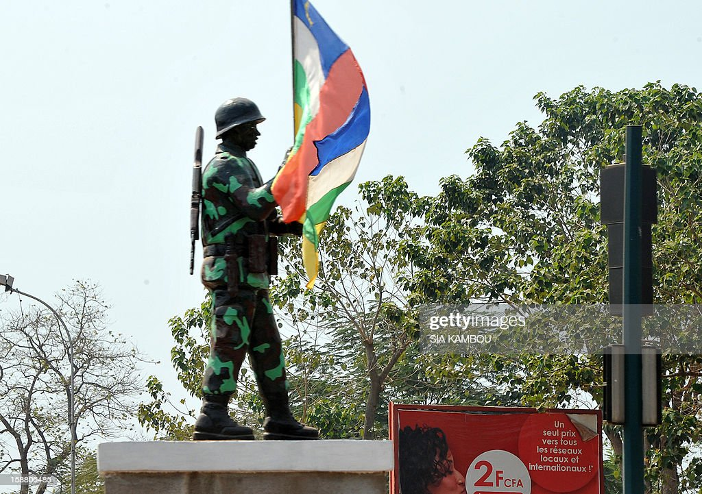 A picture shows a statue of a soldier holding a national flag, on December 29, 2012 in Bangui. Rebels in the Central African Republic, defying mediation efforts, on December 29, 2012 seized another town in their advance on the capital, forcing an army retreat and putting them just one town away from Bangui. The rebels, who already have control of four other regional capitals in the centre and north of the country, faced no resistance as they entered the town of Sibut around 150 kilometres (95 miles) from Bangui, a military official told AFP. AFP PHOTO/ SIA KAMBOU