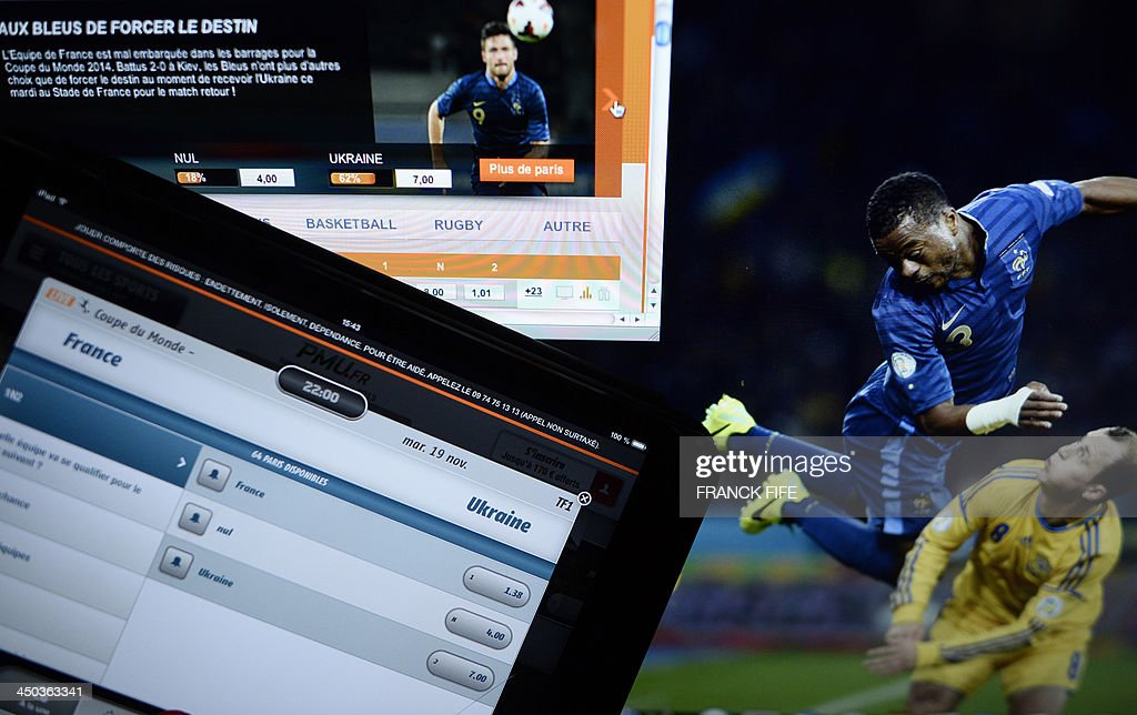 A picture shows a tablet computer's screen with a page of an online betting website on November 18 2013 in Paris Over 13 million euros in bets were...