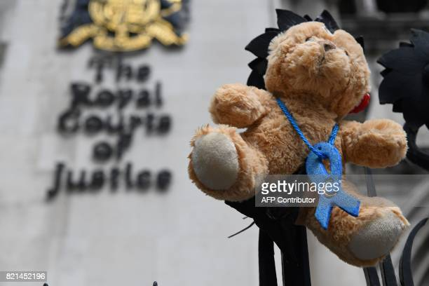 A picture shows a teddy bear set up by supporters of the family of British baby Charlie Gard outside the Royal Courts of Justice in London on July 24...