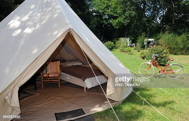 FERRER A picture shows a tent in the Orangerie de Lanniron luxury camping ground in Quimper western of France on August 20 2014 Glamping from glamour...