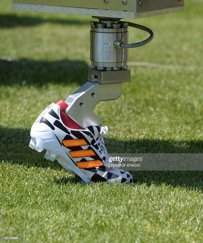 Picture shows a tester engine for football shoes in the innovation test center of the German sports goods company Adidas at the company's headquarters in Herzogenaurach, southern Germany, on June 24, 2014.