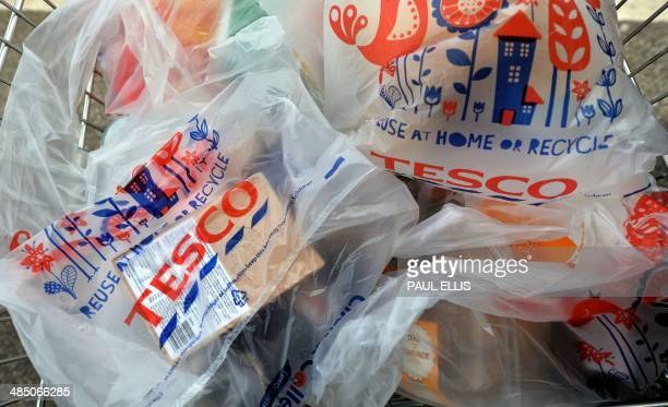 A picture shows a trolly of shopping a Tesco store in Liverpool north west England on April 16 2014 Supermarket giant Tesco announced a second drop...