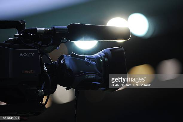 A picture shows a TV camera filming the French L1 football match between Nantes and Bordeaux on March 29 2014 at the Beaujoire stadium in Nantes...