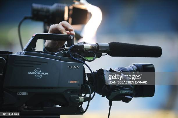 A picture shows a TV camera of the production company AmpVisualTV a provider for French TV Sport channel BeIN Sport that belongs to Qatari media...