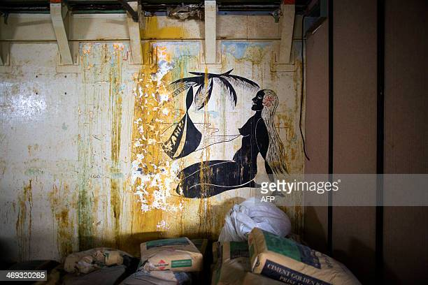 A picture shows a wall painting of a vahine woman inside the fire command post in the army base of Moruroa atoll southern Pacific ocean where French...