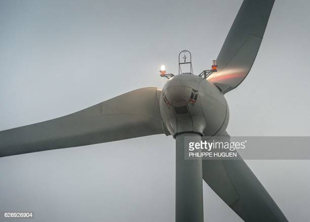 A picture shows a wind turbine in Fruges northern France on November 28 2016 / AFP / PHILIPPE HUGUEN