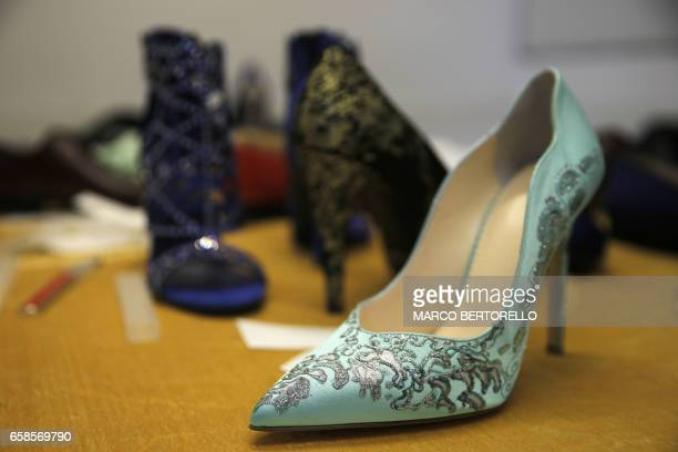 A picture shows a woman shoe with silver dust patterns made by artisans for AV Fashion on March 16 2017 in Turin Antonio Vietri founder of AV Fashion...