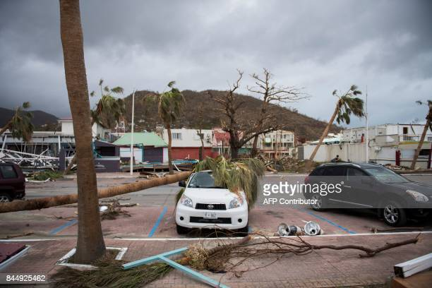 A picture shows a wrecked car in the streets of Marigot on September 9 2017 in SaintMartin island devastated by Irma hurricane Officials on the...