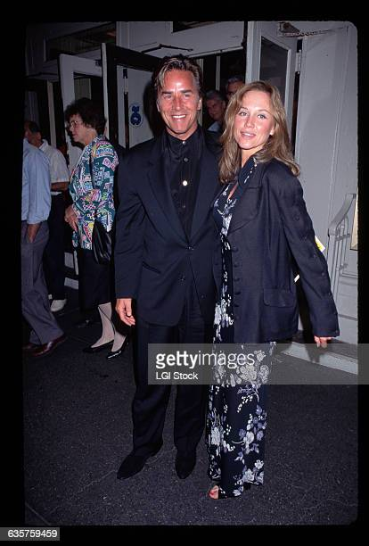 1995 Picture shows actor Don Johnson posing with his girlfriend/socialite Kerry Whitman on the street He is in a black suit and she is wearing a blue...