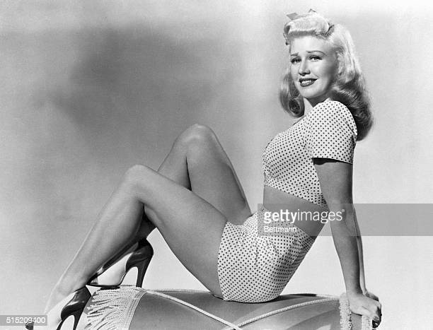 1947 Picture shows actress and dancer Ginger Rogers posing in a twopiece bathing suit and a pair of heels