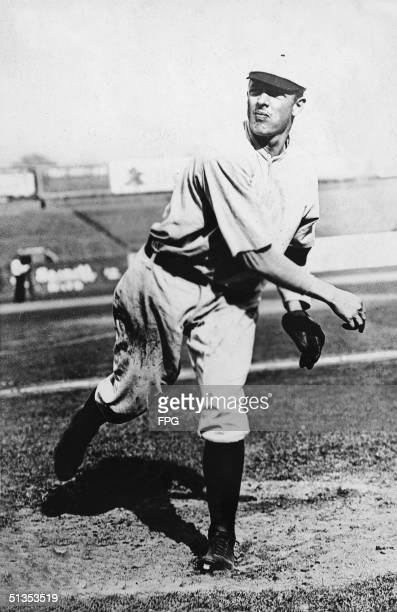 Picture shows American baseball pitcher Christy mathewson in the follow through of a pitch 1900s Methewson was an original inductee into the Baseball...