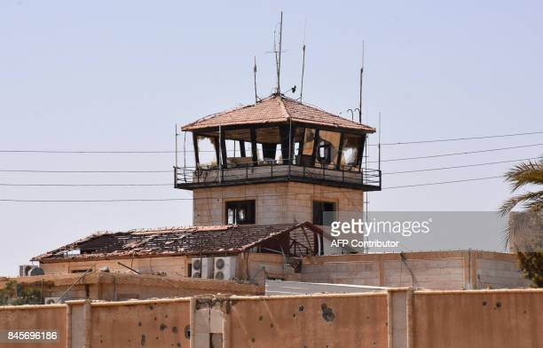 A picture shows an abandoned control tower at the military airport in the eastern Syrian city of Deir Ezzor on September 11 as Syrian government...