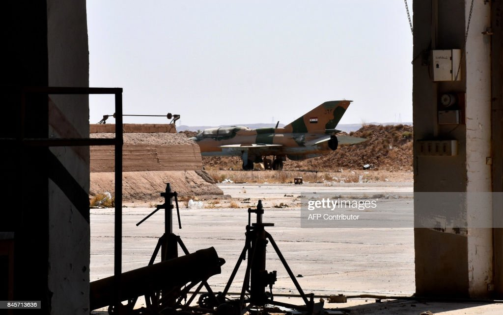 A picture shows an abandoned fighter jet at the military airport in the eastern Syrian city of Deir Ezzor on September 11, 2017, as Syrian government forces continue to press forward with Russian air cover in the offensive against Islamic State group jihadists across the province. Syrian troops broke the Islamic State group's siege of Deir Ezzor military airport on September 9, dealing a fresh blow to the jihadists who also face a new offensive from US-backed fighters elsewhere in the province. / AFP PHOTO / George OURFALIAN