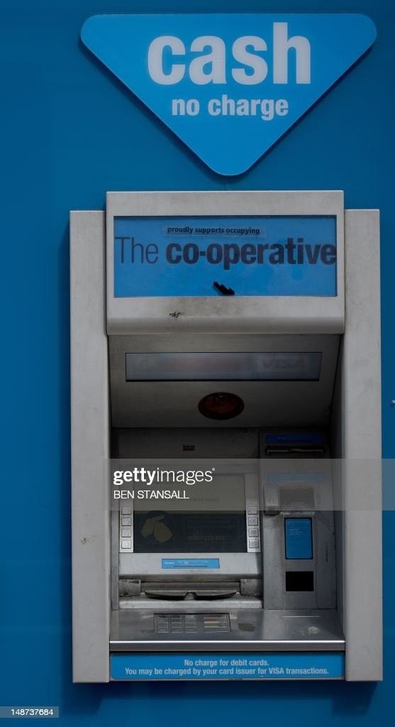 A picture shows an ATM outside a branch of the Co-operative Bank in London on July 19, 2012. Britain's retail bank sector faced further shake-up on July 19 as state-rescued Lloyds Banking Group agreed to sell 632 branches at a loss to The Co-operative Group after an EU competition ruling.
