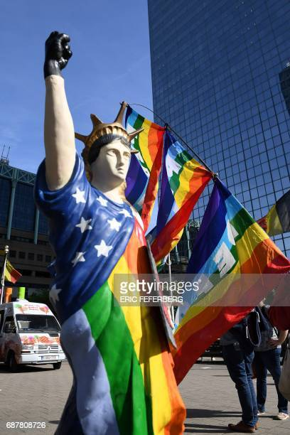 A picture shows an effigy of the Statue of Liberty wearing a black glove and a rainbow flag during a demonstration againt the US president in...