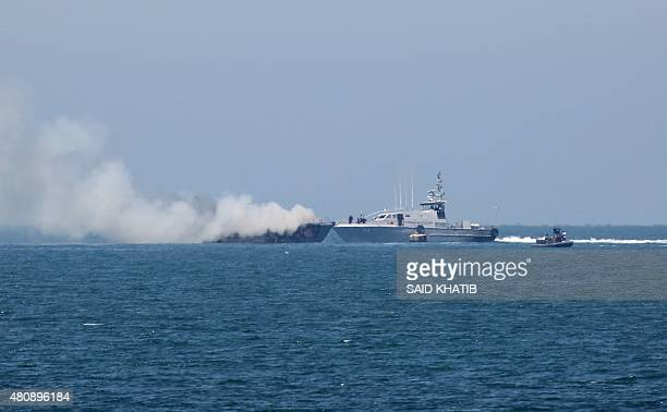 A picture shows an Egyptian naval vessel approaching another army boat on fire on the maritime border between Egypt and the Palestinian Gaza Strip...