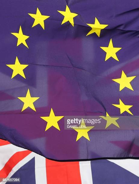 A picture shows an EU flag and a Union Flag held by a demonstrator in Parliament Square during an antiBrexit proEuropean Union march in central...