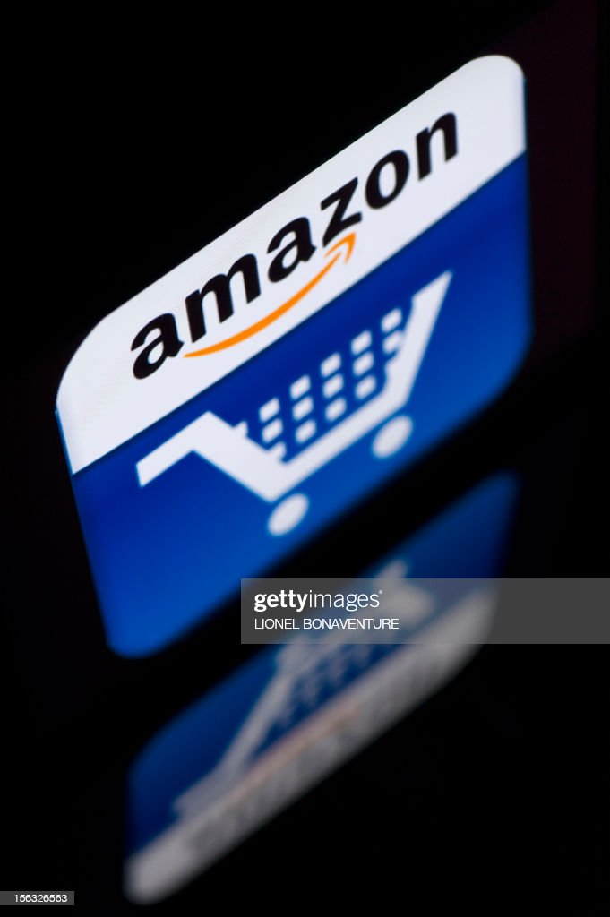 A picture shows an Ipad with an 'Amazon' logo on November 13, 2012 in Paris. French tax authorities have demanded $252 million in back taxes and interest from online retailer Amazon, according to a company document on November 13, 2012.AFP PHOTO / LIONEL BONAVENTURE