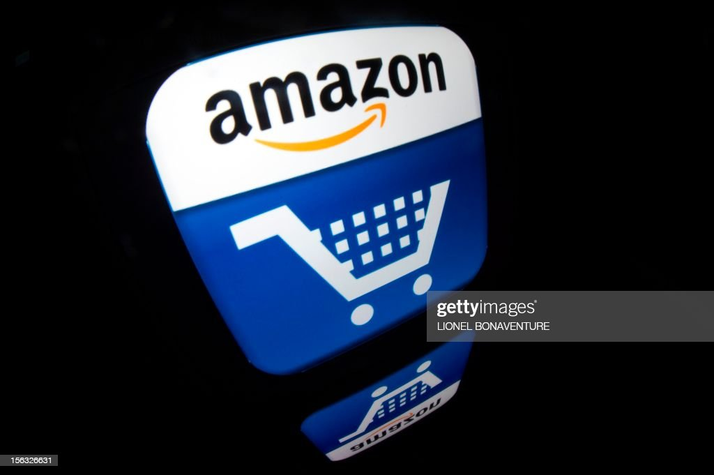 A picture shows an Ipad with an 'Amazon' logo on November 13, 2012 in Paris. French tax authorities have demanded $252 million in back taxes and interest from online retailer Amazon, according to a company document on November 13, 2012.