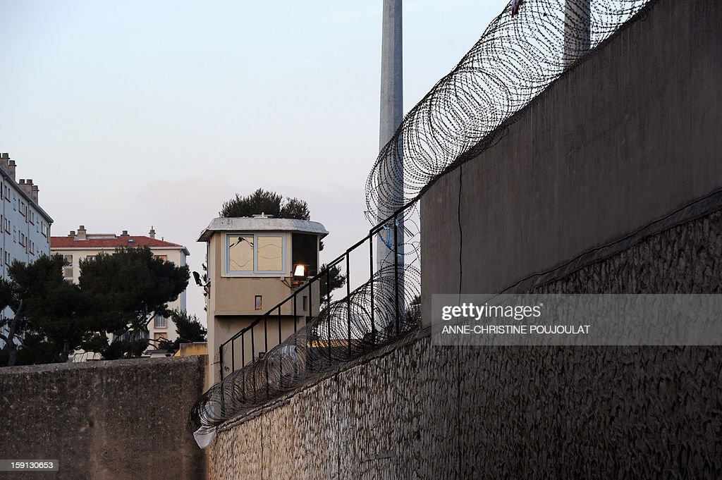 A picture shows an observation tower (mirador) of the Baumettes prison in Marseille, southern France, on January 8, 2013. French Conseil d'Etat (State Council, French highest administrate authority) ordered last month a rat-disinfestation in this overcrowed, dilapidated jail. General Inspector for jails Jean-Marie Delarue denounced in a survey last December 'serious violations of fundamental human rights', causing 'inhumane' detention conditions. AFP PHOTO / ANNE-CHRISTINE POUJOULAT