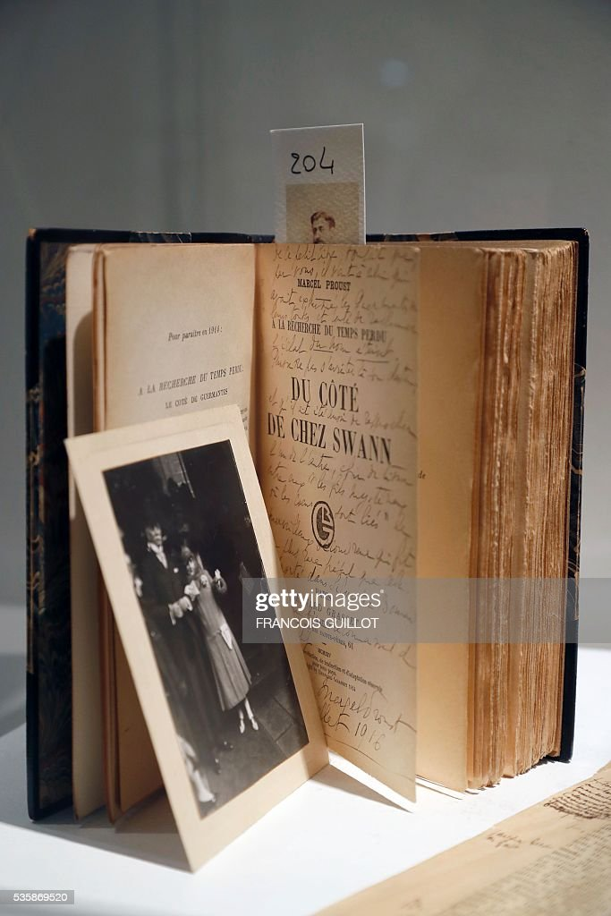 A picture shows an original edition of the novel 'Du cote de chez Swann' (Swann's Way) during the presentation of personal archives of French writer Marcel Proust, ahead of an auction at Sotheby's in Paris, on May 30, 2016. / AFP / FRANCOIS