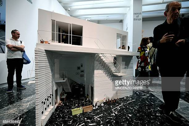 A picture shows appartments projects in Japan's pavillion during the opening of the 15th International Architecture Exhibition in Venice on May 26...