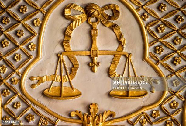 A picture shows balance scales symbolising justice at the courthouse of Douai in northern France on June 25 2015 AFP PHOTO / PHILIPPE HUGUEN