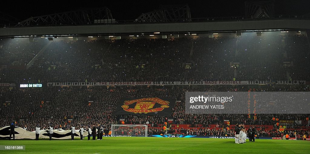 A picture shows banners in the crowd before the UEFA Champions League round of 16 second leg football match between Manchester United and Real Madrid at Old Trafford in Manchester, northwest England on March 5, 2013. AFP PHOTO / ANDREW YATES