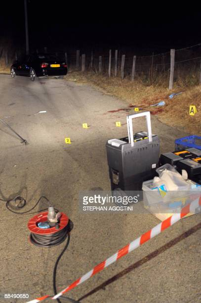Picture shows blood stains on an isolated road on June 15 2009 in Mezzavia near Ajaccio on the French Mediterranean island of Corsica after a man was...