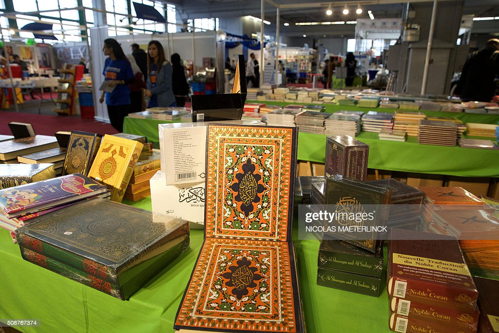 A picture shows books, including Korans, displayed on the first day of 'Muslim Expo', the first muslim fair in Wallonia after editions in Brussels and Flanders, on February 6, 2016 in Charleroi. / AFP / Belga / NICOLAS MAETERLINCK / Belgium OUT