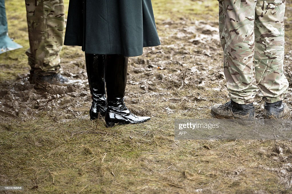 A picture shows Britain's Camilla, Duchess of Cornwall's boots as she meets British soldiers from R Company, 4th Battalion, The Rifles (4 RIFLES), during a visit at Ward Barracks in Bulford, Wiltshire on January 29, 2013. The Duchess of Cornwall, Royal Colonel, 4th Battalion, The Rifles, visited the battalion during their pre-deployment training.