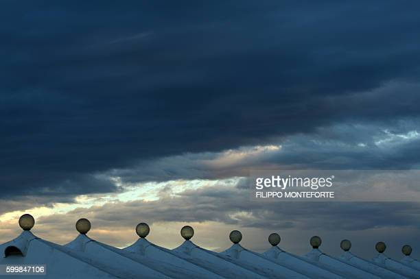 A picture shows cabins' roof at sunset on the beach at Venice Lido during the 73rd Venice Film Festival on September 6 2016 / AFP / FILIPPO MONTEFORTE