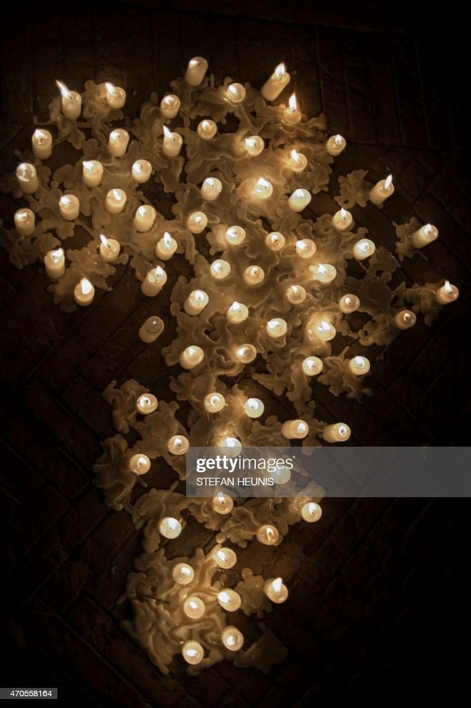A picture shows candles placed on the ground to form the shape of the African continent during a silent vigil against xenophobia held at Constitution...