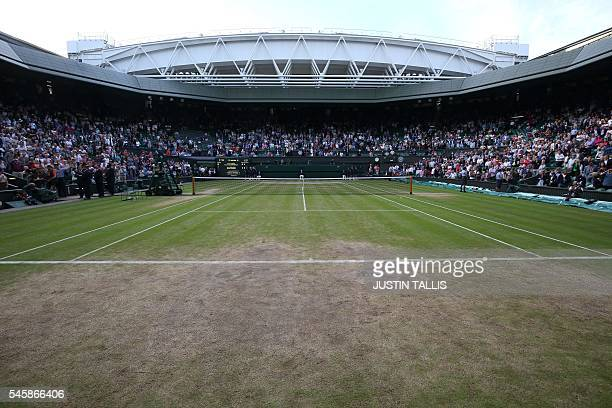 A picture shows centre court at the end of the 2016 Wimbledon Championships at The All England Lawn Tennis Club in Wimbledon southwest London on July...